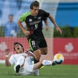 Oct. 23, 2011 - Guadalajara, Mexico - JERONIMO ARTURO AMIONE of Mexico moves the ball over DIEGO MARTIN RODRIGUEZ of Uruguay during the second half of the soccer (football) match Mexico vs Uruguay, part of the Pan American Games. Mexico won the match 5-2 over Uruguay.